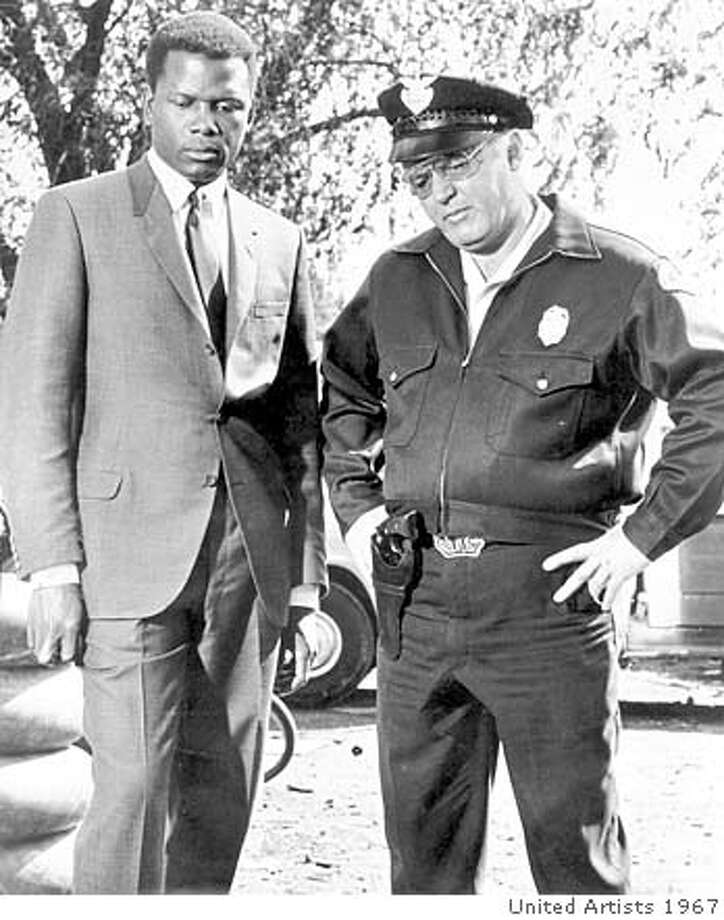 """(NYT3) UNDATED -- July 9, 2002 -- OBIT-STEIGER-B&W -- Rod Steiger, who won the 1967 Oscar for best actor for his role as the redneck Southern police chief in """"In the Heat of the Night,"""" died Tuesday. He was 77. Steiger, right, with Sidney Poitier in the film. (United Artists/The New York Times) *LITE CAT XNYZ XNYT Photo: UNITED ARTISTS"""