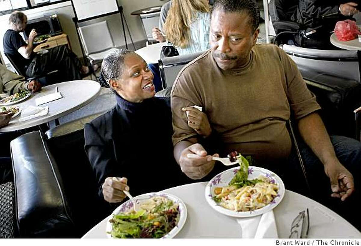 """Janet (left) and Jimmy Boone enjoy their dinner together. They have lived at the hotel for three years. """"Dinner With Grace"""" is a volunteer program where Grace Cathedral members cook a sit down meal once a month with residents of a hotel in the Tenderloin district of San Francisco. This week the meal is served at the Coast Hotel on O'Farrell Street in San Francisco, CA."""