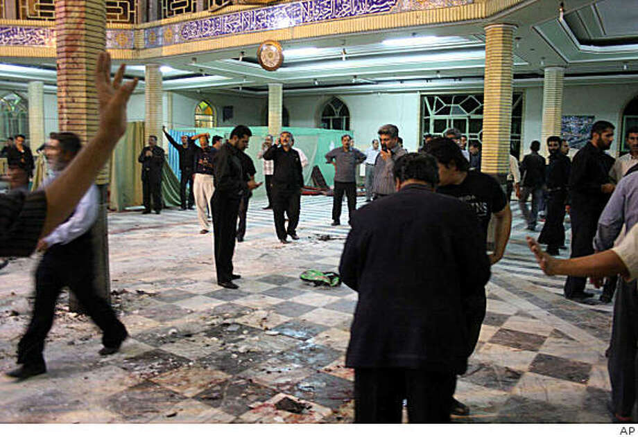 Iranians are seen inside the mosque after an explosion killed 15 in Zahedan, Iran,Thursday May. 28, 2009. An explosion in a mosque killed 15 people and wounded 50 Thursday in southeast Iran near the volatile Pakistani border, the state news agency said. Iranian officials were investigating the cause of the explosion in the city of Zahedan, some 1,000 miles (1,600 kilometers) southeast of the capital, Tehran, said the Islamic Republic News Agency.(AP Photo/Islamic Republic News Agency) Photo: AP