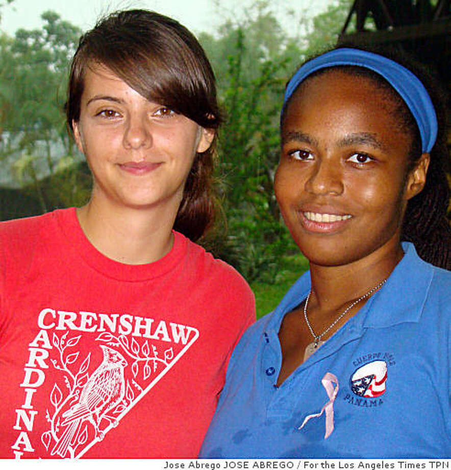 PEACECORPS: Alexandra Hodgkins, left, of New Hampshire and Yemiymah Yisrael of Chicago are volunteering with the Peace Corps in Santa Fe, Panama. Yisrael extended her stay. Illustrates PEACECORPS (category i) by Chris Kraul (c) 2009, Los Angeles Times. Moved Tuesday, June 2, 2009. (MUST CREDIT: Photo for the Los Angeles Times by Jose Abrego.)Alexandra Hodgkins, left, of New Hampshire and Yemiymah Yisrael of Chicago are volunteering with the Peace Corps in Santa Fe, Panama. Yisrael extended her stay. Illustrates PEACECORPS (category i) by Chris Kraul (c) 2009, Los Angeles Times. Moved Tuesday, June 2, 2009. (MUST CREDIT: Photo for the Los Angeles Times by Jose Abrego.) Photo: Jose Abrego JOSE ABREGO, For The Los Angeles Times TPN