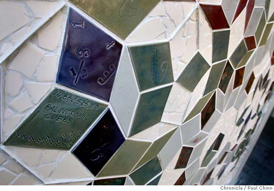 A wall of mosaic tiles features math computations at the entrance to the Mathematical Sciences Research Institute in Berkeley, Calif. on Thursday, Jan. 17, 2008. MSRI, located in the Berkeley Hills above the Lawrence Hall of Science, is celebrating its 25th anniversary this year. MANDATORY CREDIT FOR PHOTOGRAPHER AND S.F. CHRONICLE/NO SALES - MAGS OUT Photo: PAUL CHINN