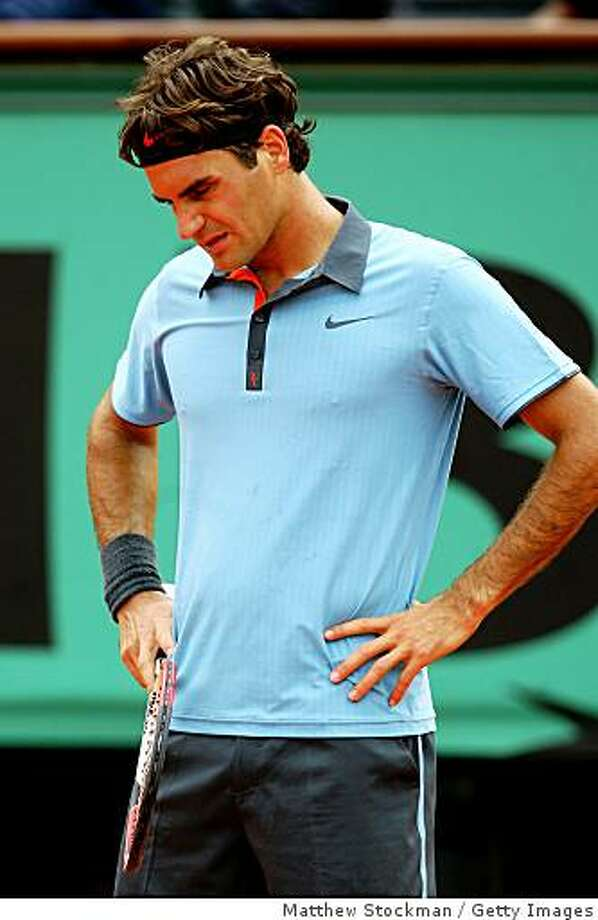 PARIS - MAY 28:  Roger Federer of Switzerland looks dejected during his Men's Singles Second Round match against Jose Acasuso of Argentina on day five of the French Open at Roland Garros on May 28, 2009 in Paris, France.  (Photo by Matthew Stockman/Getty Images) Photo: Matthew Stockman, Getty Images