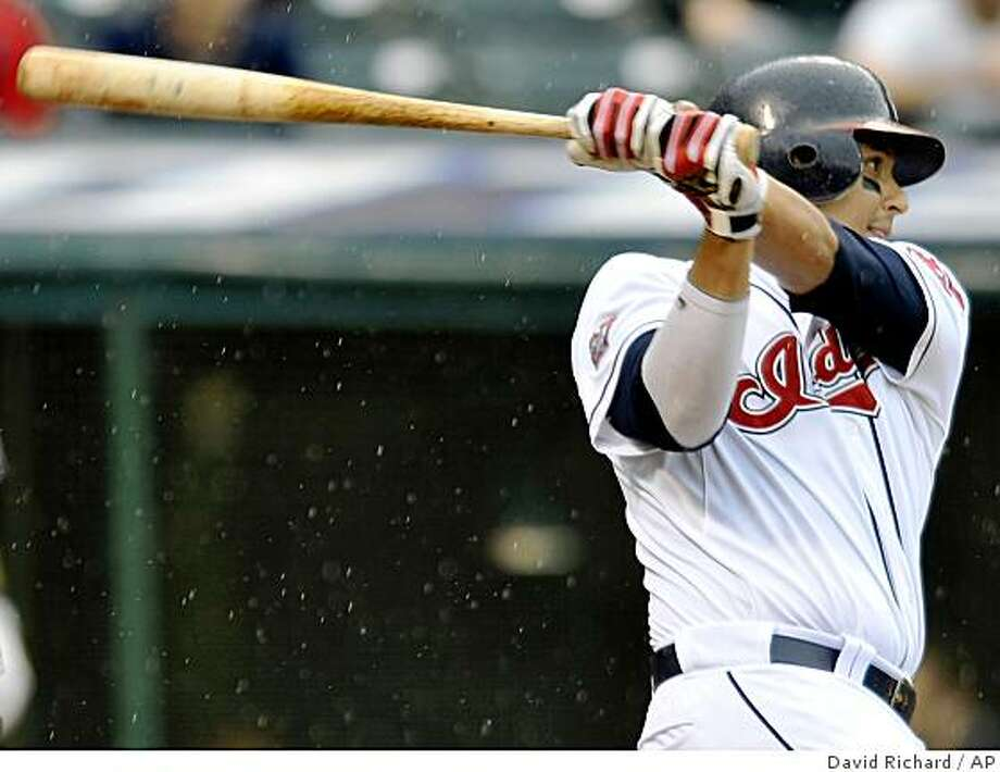 Cleveland Indians Victor Martinez lines an RBI-single to score teammmate Kelly Shoppach in the fifth inning of a baseball game against the Tampa Bay Rays on Thursday, May 28, 2009, in the rain at Progressive Field in Cleveland, Ohio. (AP Photo/David Richard) Photo: David Richard, AP