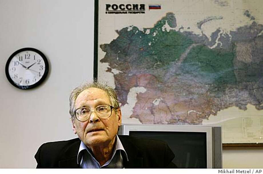 **ADVANCE FOR SUNDAY, MAY 31** In this photo taken Monday, April 13, 2009, Sergei Kovalyov speaks to The Associated Press in Moscow as a map of  Russia is partly seen in the background. 79-year-old Kovalyov regarded by some as the patriarch of the dissident movement is almost forgotten at home. His critique of the new Russia is unyielding, much of it directed against Vladimir Putin, admired by many for restoring Russia's greatness, and the activist knows that few Russians are likely to mourn his passing.(AP Photo/Mikhail Metzel) Photo: Mikhail Metzel, AP