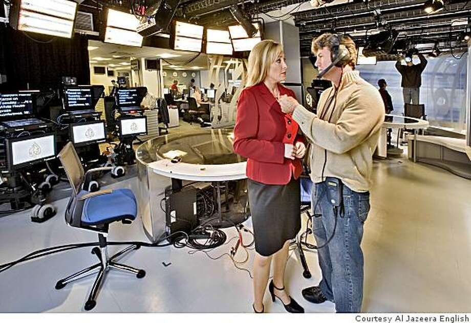 Correspondent Kimberly Halkett in the Washington, D.C. newsroom of Al Jazeera English, which will be carried beginning Monday on Link TV of San Francisco. Photo: Courtesy Al Jazeera English