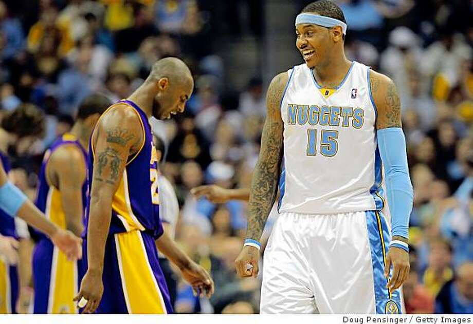 DENVER - MAY 25:  (R-L) Carmelo Anthony #15 of the Denver Nuggets reacts in the third quarter as Kobe Bryant #24 of the Los Angeles Lakers walks by in Game Four of the Western Conference Finals during the 2009 NBA Playoffs at Pepsi Center on May 25, 2009 in Denver, Colorado. NOTE TO USER: User expressly acknowledges and agrees that, by downloading and or using this photograph, User is consenting to the terms and conditions of the Getty Images License Agreement.  (Photo by Doug Pensinger/Getty Images) Photo: Doug Pensinger, Getty Images