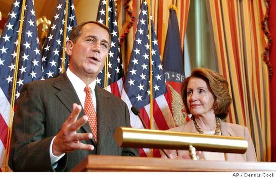 House Minority Leader John Boehner of Ohio, left, accompanied by House Speaker Nancy Pelosi of Calif., talk to reporters on Capitol Hill in Washington, Tuesday, Jan. 29, 2008, after the House approved and economic stimulus package. (AP Photo/Dennis Cook) Photo: Dennis Cook