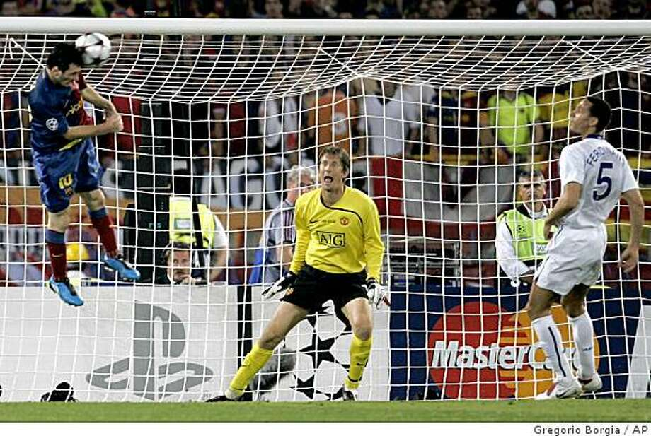 Barcelona's Lionel Messi, left, scores on a header during the UEFA Champions League final soccer match between Manchester United and Barcelona in Rome, Wednesday May 27, 2009. Barcelona won 2-0. (AP Photo/Gregorio Borgia) Photo: Gregorio Borgia, AP