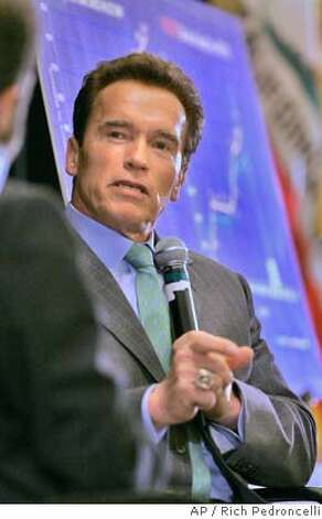Gov. Arnold Schwarzenegger gestures while answering questions during his appearance at the California Newspaper Publishers Association luncheon in Sacramento, Calif., Wednesday, Jan. 23, 2008. Discussing his health care reform plan before the legislature, Schwarzenegger said he confident that lawmakers would eventually pass the bill. (AP Photo/Rich Pedroncelli) Photo: Rich Pedroncelli