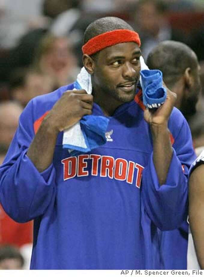 **FILE** Detroit Pistons' Chris Webber watches his team from the bench during an NBA basketball game against the Chicago Bulls in this May 10, 2007 file photo in Chicago. More than 13 years after Webber demanded to leave the Golden State Warriors, the free-agent forward is all set to return. Webber sent an e-mail to The Associated Press on Monday, Jan. 28, 2008, confirming he will rejoin the Warriors. (AP Photo/M. Spencer Green, File) Photo: M. Spencer Green