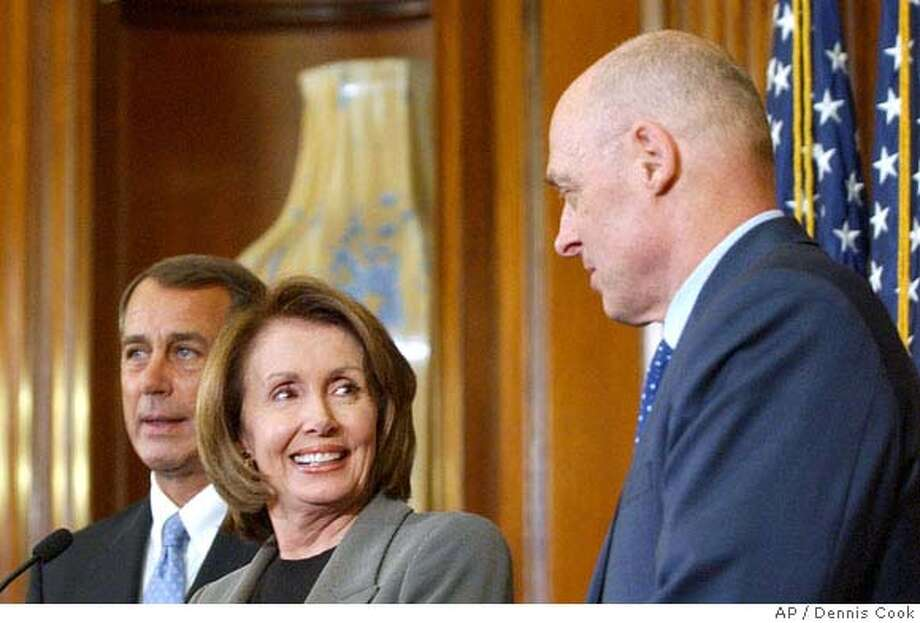 House Speaker Nancy Pelosi of Calif., center, smiles toward Treasury Secretary Henry Paulson, right, during a news conference on Capitol Hill in Washington, Thursday, Jan. 24, 2008, where they discussed a bipartisan economic stimulus package. House Minority Leader John Boehner of Ohio is at left. (AP Photo/Dennis Cook) Photo: Dennis Cook