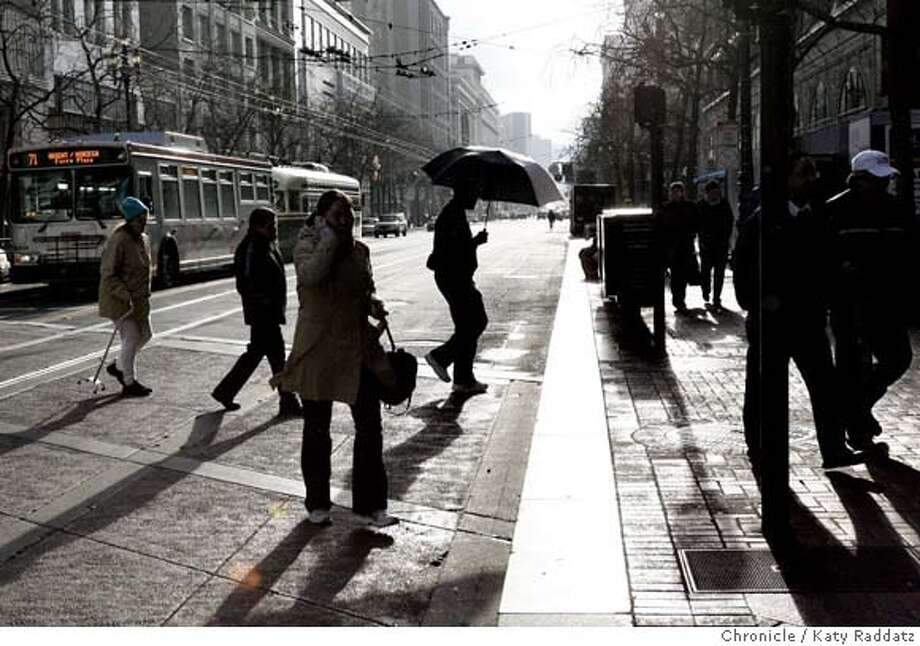 WEATHER  Pedestrians cross Market St. at Kearny St. on a cold day in San Francisco, featuring occasional drops from the sky which brought occasional umbrellas. These pictures were made on Tuesday, Jan. 22, 2008, in San Francisco, CA. KATY RADDATZ/The Chronicle MANDATORY CREDIT FOR PHOTOG AND SAN FRANCISCO CHRONICLE/NO SALES-MAGS OUT Photo: KATY RADDATZ