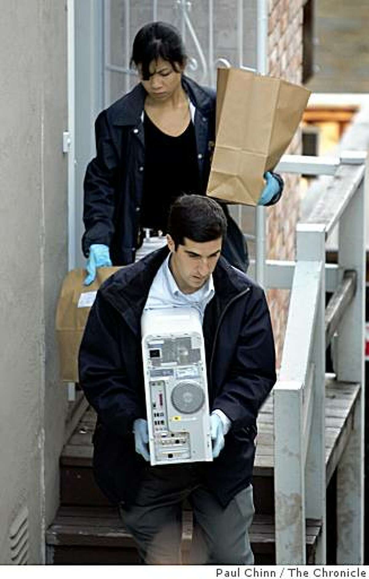 Federal agents removed two desktop computers and several unmarked bags of evidence from Nick Perata's home. FBI and IRS authorities served a search warrant at the home of Nick Perata on 12/15/04 in Oakland, CA. Perata and his father state Senate Leader Don Perata are under federal investigation.