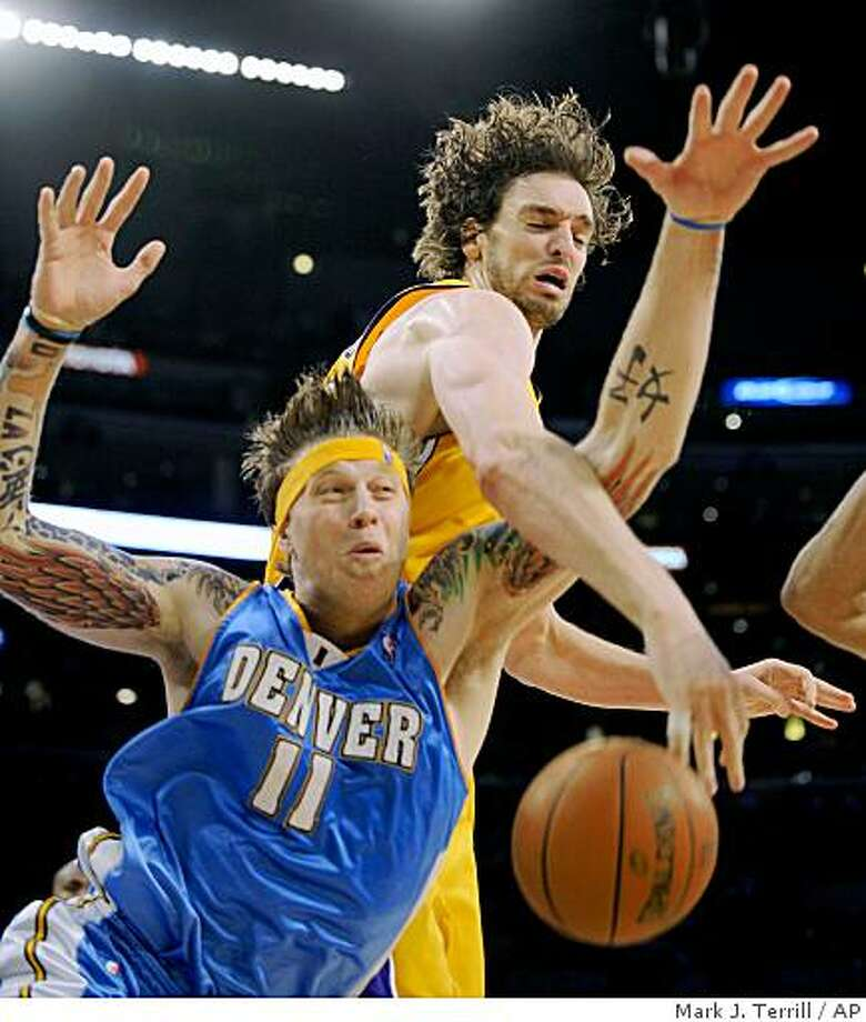 Los Angeles Lakers forward Pau Gasol, of Spain, knocks the ball away from Denver Nuggets forward Chris Andersen during the second half of Game 5 in the NBA Western Conference basketball finals, Wednesday, May 27, 2009, in Los Angeles. (AP Photo/Mark J. Terrill) Photo: Mark J. Terrill, AP