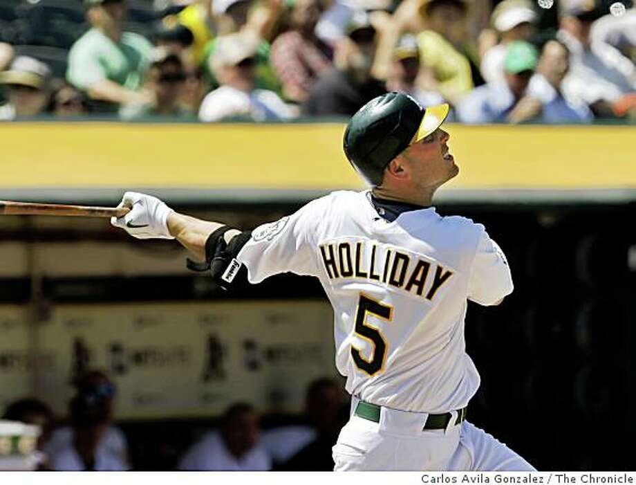 Matt Holliday bats in the bottom of the eighth inning, popping out and went 0-4 in the game. The Oakland Athletics played the Seattle Mariners at the Oakland-Alameda County Coliseum on Wednesday, May 27, 2009. The Mariners won the game 6-1. Photo: Carlos Avila Gonzalez, The Chronicle