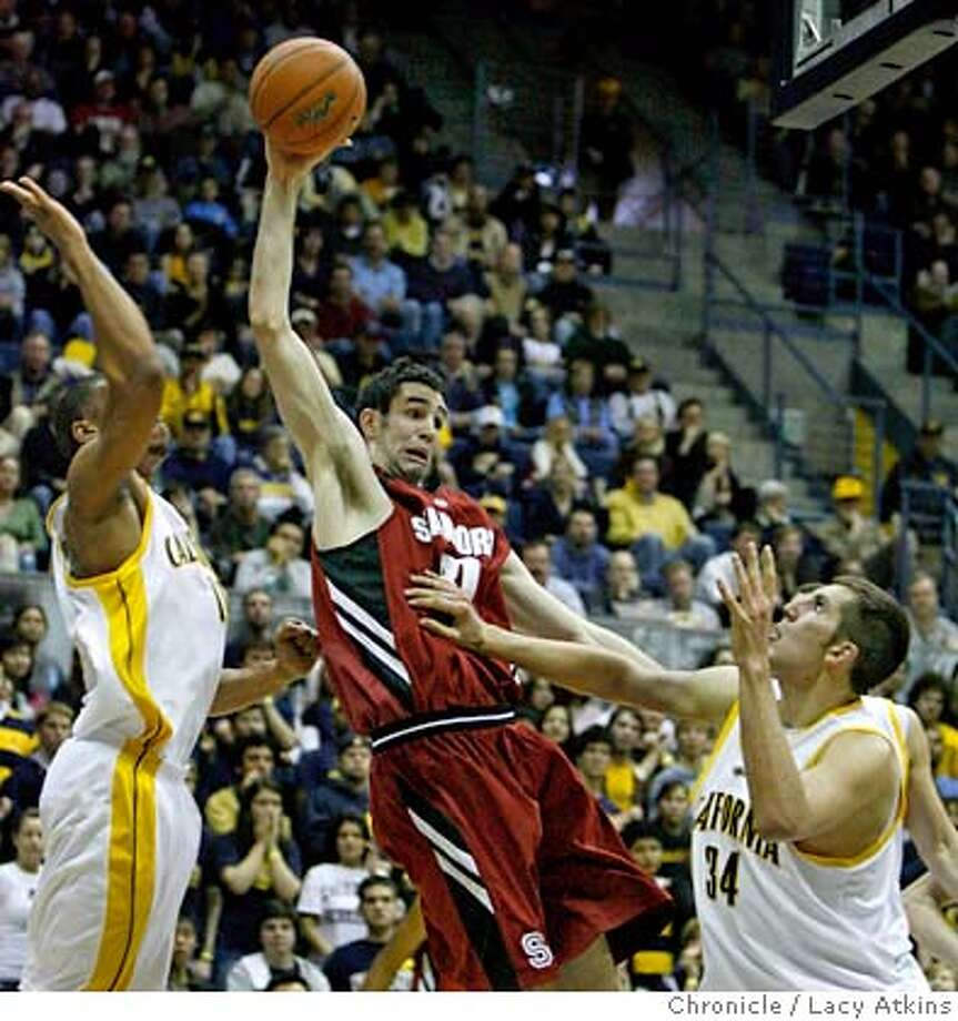 Stanfords Tai Finger struggles to pass the ball past Cals. Ryan Anderson in the first half of the game against the California Golden Bears, Saturday January 26, 2008, in Berkeley, Ca. (Lacy Atkins San Francisco Chronicle) Photo: Lacy Atkins