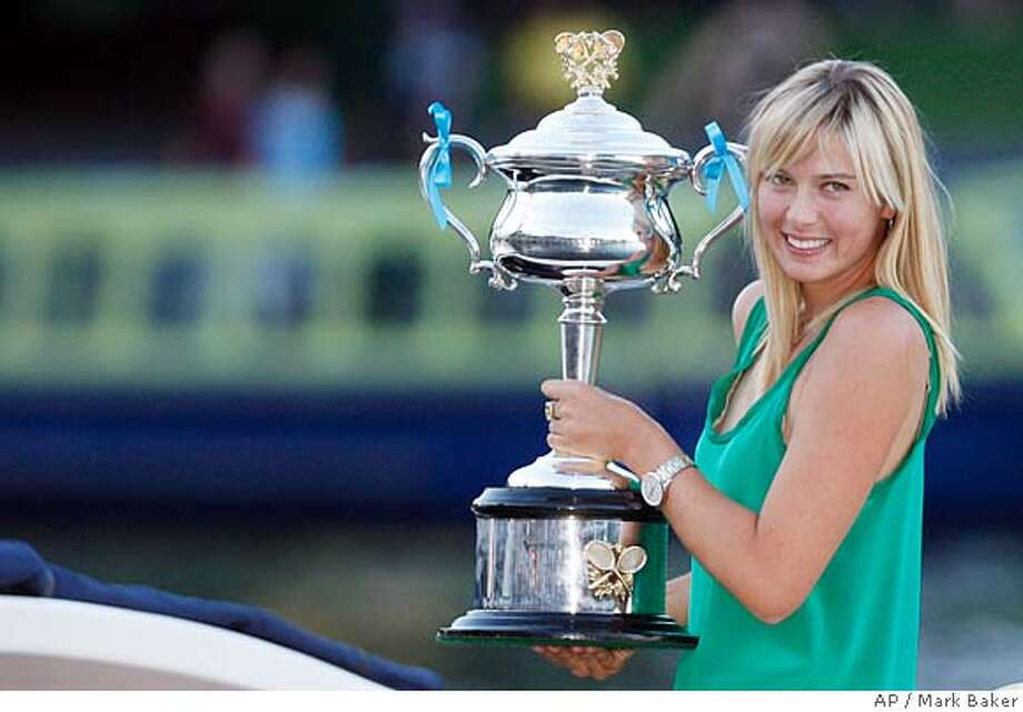 Russia's Maria Sharapova smiles as she holds trophy during a photo call on a boat on the Yarra river in downtown Melbourne after beating Serbia's Ana Ivanovic to win the final of the Women's singles at the Australian Open tennis tournament in Melbourne, Australia, Saturday, Jan. 26, 2008. (AP Photo/Mark Baker) Photo: Mark Baker
