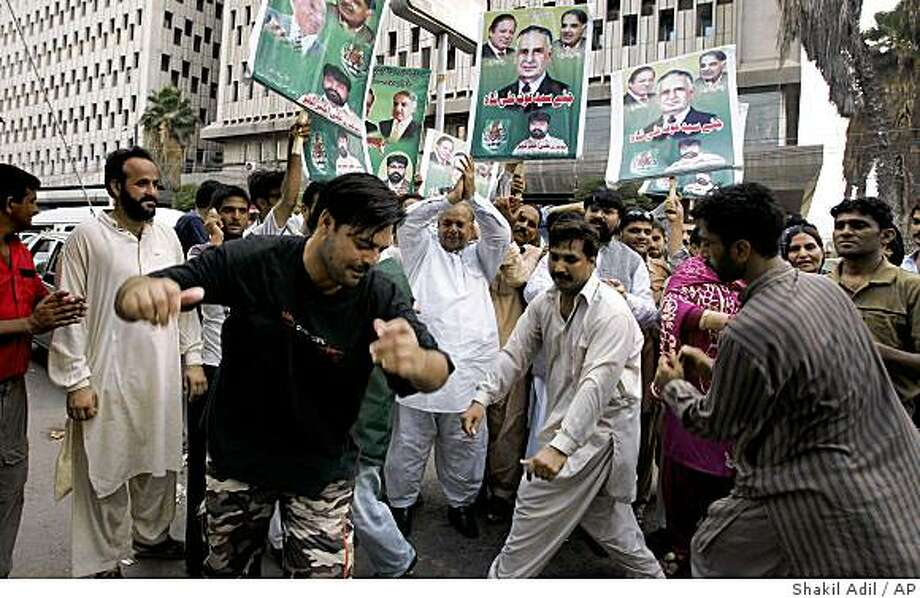 Supporters of Pakistani opposition leader Nawaz Sharif dance to celebrate the Supreme Court decision in Karachi, Pakistan on Tuesday, May 26, 2009. Pakistan's top court Tuesday lifted an election ban on Sharif, giving the former prime minister a major political boost by allowing him to run for office. (AP Photo/Shakil Adil) Photo: Shakil Adil, AP