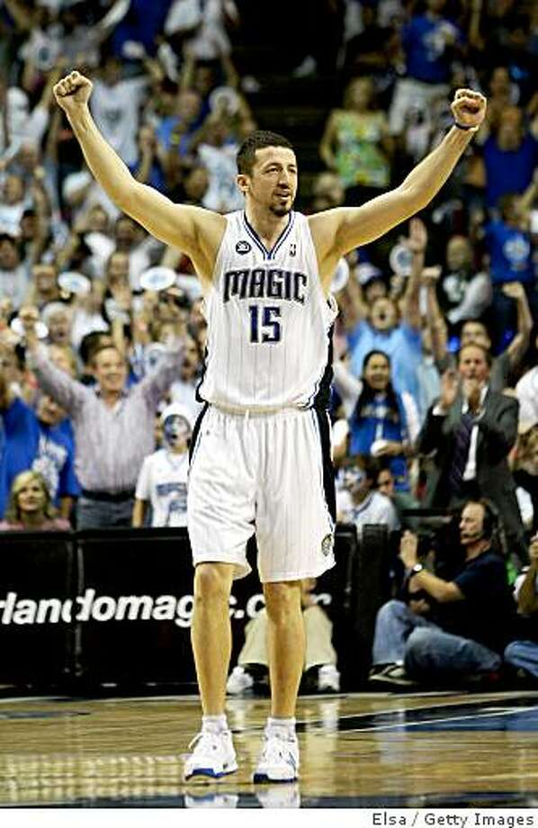 ORLANDO, FL - MAY 26:  Hedo Turkoglu #15 of the Orlando Magic celebrates a three point shot by teammate Rashard Lewis to take the lead 100-98 over the Cleveland Cavaliers in the fourth quarter of Game Four of the Eastern Conference Finals during the 2009 NBA Playoffs at the Amway Arena on May 26, 2009 in Orlando, Florida. NOTE TO USER: User expressly acknowledges and agrees that, by downloading and or using this photograph, User is consenting to the terms and conditions of the Getty Images License Agreement.  (Photo by Elsa/Getty Images) Photo: Elsa, Getty Images