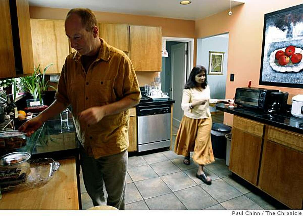 Matt Bording and his wife Mangala Abeysinghe work in the kitchen of their home in Richmond, Calif., on Friday, April 10, 2009. Since they purchased the home in 2005, the value has plummeted in recent years and is now under water by $150,000.