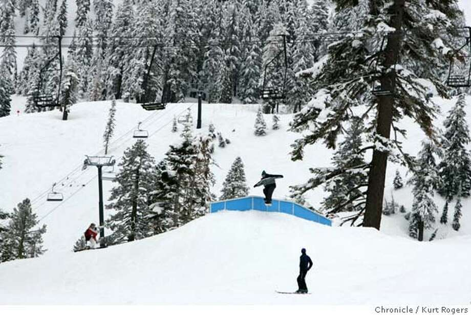 A rider hits the rail at Alpine Meadows.  FIS Fres Noram tour for Halfpipe. at Alpine Meadows .  and the terrain park.  FUNPARK24_0002_kr.JPG 2/17/05 in NORTH LAKE TAHOE,CA.  KURT ROGERS/THE CHRONICLE Ran on: 07-31-2007  Snowboarders enjoy the slopes at Alpine Meadows, which has been purchased by a San Francisco investment company. Photo: KURT ROGERS