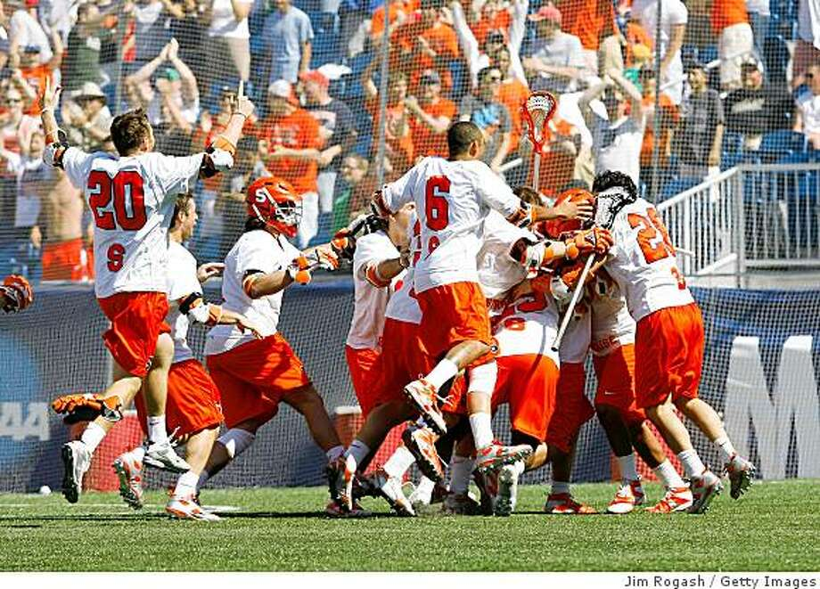 FOXBOROUGH, MA - MAY 25:  Syracuse Orange celebrates after defeating the Cornell Big Red, 10-9, in overtime for NCAA Division I Lacrosse Championship at Gillette Stadium May 25, 2009 in Foxborough, Massachusetts.  (Photo by Jim Rogash/Getty Images) Photo: Jim Rogash, Getty Images