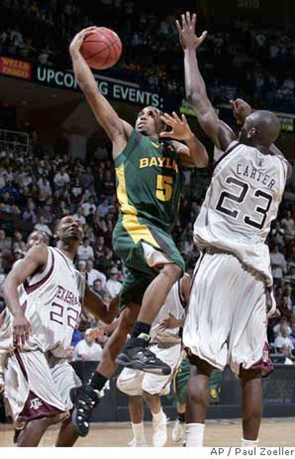 Baylor's Henry Dugat (5) cuts to the basket between Texas A&M's Josh Carter(23), and Dominique Kirk during the second half of their basketball game Wednesday, Jan. 23, 2008, at Reed Arena in College Station, Texas.(AP Photo/Paul Zoeller) EFE OUT Photo: Paul Zoeller