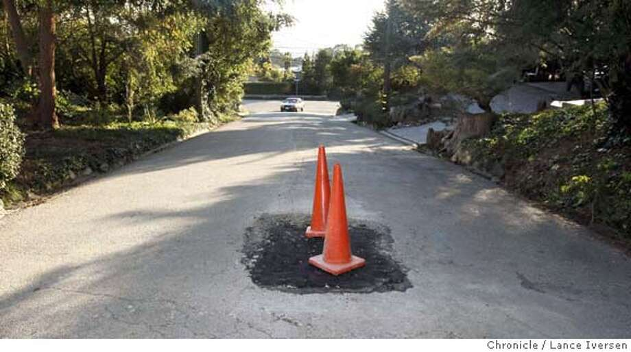 Two traffic cones mark a temporary patch on the 8500 block of Buckingham. The City of El Cerrito is asking it's voters to approve a half-cent sales tax on the Feb 5th ballet that will fix many of the cities potholes and cracked asphalt streets. By Lance Iversen/The Chronicle MANDATORY CREDIT PHOTOG AND SAN FRANCISCO CHRONICLE/NO SALES MAGS OUT Photo: Lance Iversen