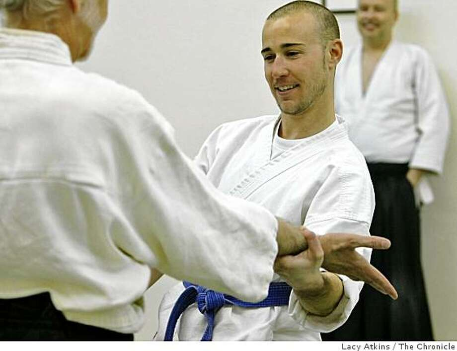 Kenneth Baker (left) works with Whitney Bagby in the Aikido class, Monday March 30, 2009, at Heart of San Francisco Aikido in San Francisco, Calif. Photo: Lacy Atkins, The Chronicle