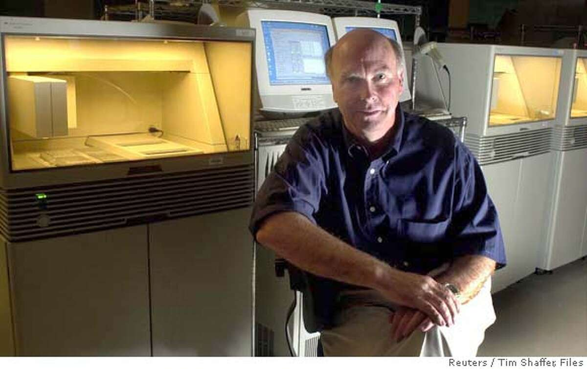 Celera Genomics President J. Craig Venter sits near a DNA sequencer in the sequencing lab of the company's facility in Rockville, Maryland, in this June 13, 2000 file photo. Venter, the pioneer scientist who helped crack the human genome, and Nobel laureate Hamilton Smith were expected to announce on November 21, 2002 plans to create a new life form in a laboratory dish in an experiment that raises ethical and safety questions, according to a published report. Venter and Smith hope to create a single-celled, partially man-made organism with the minimum number of genes necessary to sustain life in a project funded by a $3 million grant from the U.S. Energy Department, The Washington Post reported in its Thursday editions. If the experiment works, the paper said, the microscopic man-made cell would begin feeding and dividing to create a population of cells unlike any previously known to exist. REUTERS/Tim Shaffer-Files CAT 0