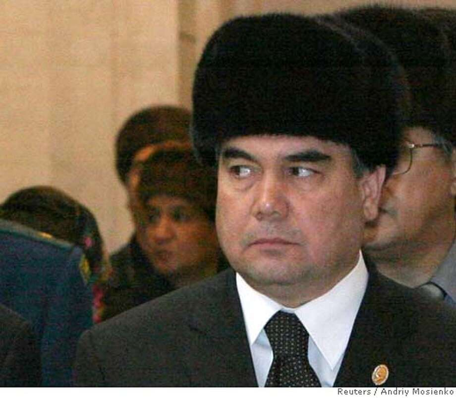 Turkmenistan's acting President Kurbanguly Berdymukhamedov stands near the coffin of late President Saparmurat Niyazov during his burial in Ashgabat December 24, 2006. Turkmenistan's People's Assembly on Tuesday set February 11 as the date for the new presidential election following the death of President-for-life Niyazov and approved Berdymukhamedov as a candidate for the post along with five unknowns. Picture taken December 24, 2006. QUALITY FROM SOURCE REUTERS/Andriy Mosienko/Pool (RUSSIA)  Ran on: 12-27-2006  Gurbanguli Berdymukha- medov is viewed as the favorite among the six candidates nominated. Photo: POOL