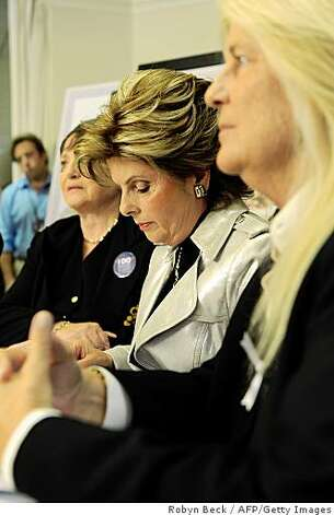 Attorney Gloria Allred (center) is flanked by married lesbian couple Robin Tyler (left) and Diane Olson (right), the original plaintiffs in the California Supreme Court marriage equality suit, after hearing the California Supreme Court decision to uphold Prop 8. Photo: Robyn Beck, AFP/Getty Images