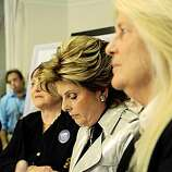 Attorney Gloria Allred (center) is flanked by married lesbian couple Robin Tyler (left) and Diane Olson (right), the original plaintiffs in the California Supreme Court marriage equality suit, after hearing the California Supreme Court decision to uphold Prop 8.