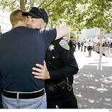 Openly gay San Francisco police officer Len Broberg (right) hugs Doug Mezzacapo a married gay man, as they wait in front of San Francisco City Hall for the California State Supreme Court to rule on the legality of a voter-approved ban on same-sex unions in San Francisco.