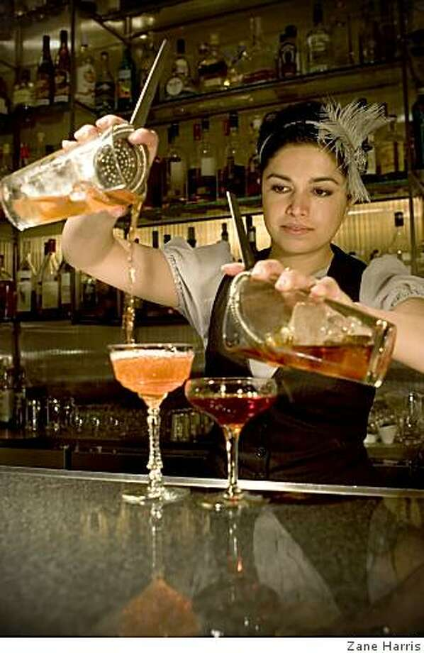 Bartender Anu Apte behind the bar at Vessel, in Seattle, Wash. Apte is one of a handful of bartenders who has done shifts in San Francisco bars as a sort of sabbatical. Photo: Zane Harris