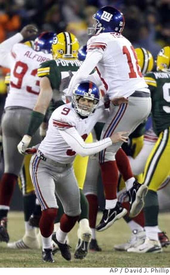 New York Giants kicker Lawrence Tynes (9) celebrates with holder Jeff Feagles after kicking the winning field goal in overtime during the NFC Championship football game against the Green Bay Packers, Sunday, Jan. 20, 2008, in Green Bay, Wis. The Giants won 23-20 and advance to the Super Bowl against the New England Patriots. (AP Photo/David J. Phillip) EFE OUT Photo: David J. Phillip