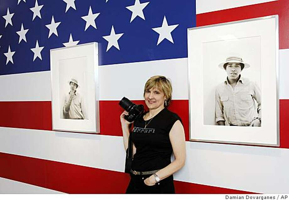 "Photographer Lisa Jack poses with her photos of  ""Barack Obama The Freshman"" at the M   F Fine Arts gallery in West Hollywood, Calif., Wednesday, May 27, 2009. Jack photographed her fellow student Obama for her Occidental College photo class nearly 30 years ago and they are now finally on display. (AP Photo/Damian Dovarganes) Photo: Damian Dovarganes, AP"