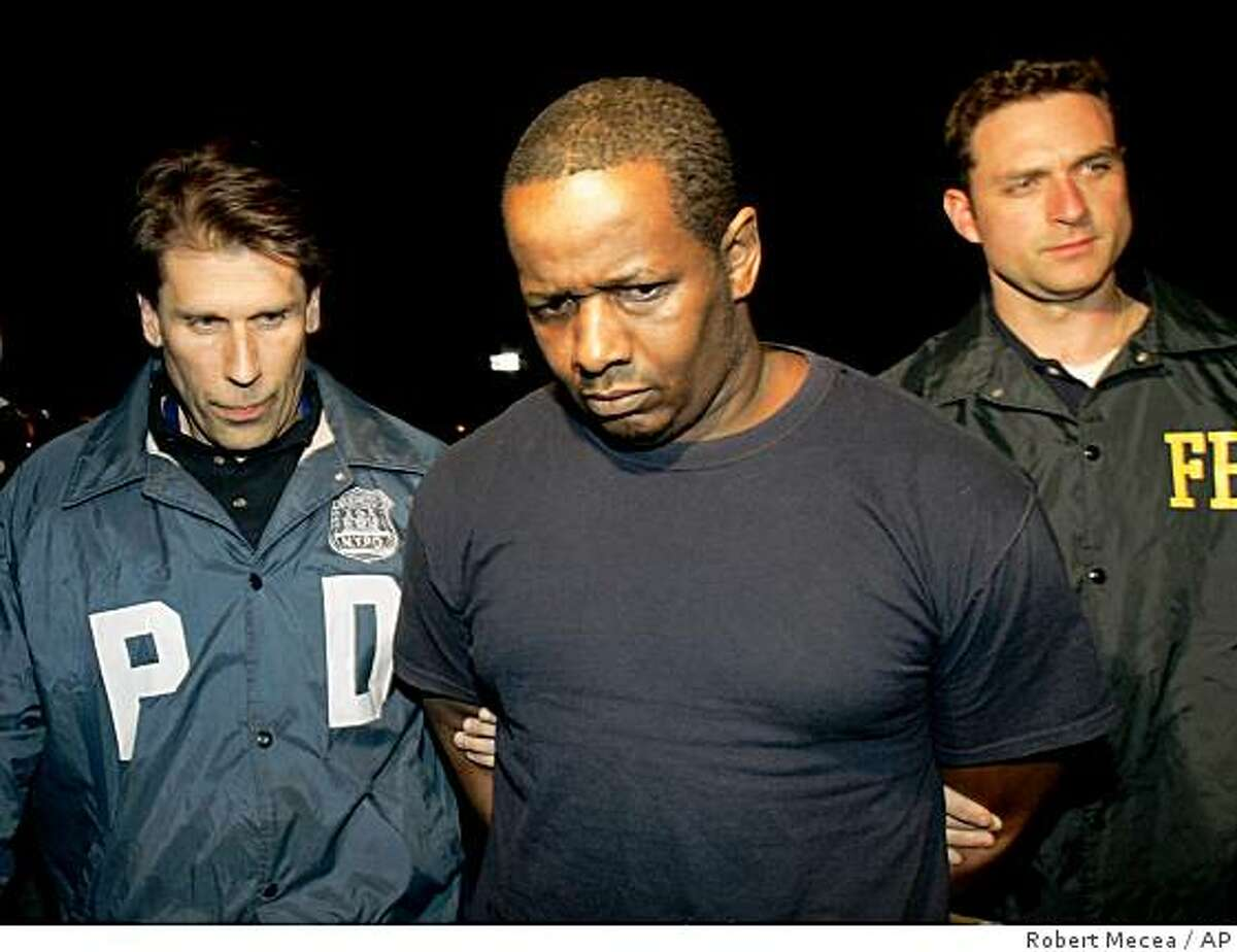 FILE - In this Thursday, May 21, 2009 picture, James Cromitie, center, is led by police officers from a federal building in New York after being arrested on charges related to a bombing plot in the Bronx. (AP Photo/Robert Mecea, file)