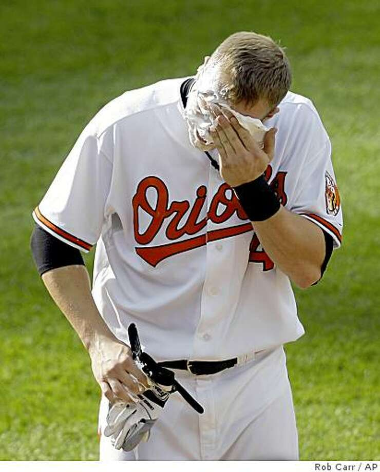 Baltimore Orioles' Nolan Reimold wipes shaving cream from his face after it was thrown at him by a teammate after they defeated the Toronto Blue Jays 12-10 in extra innings of a baseball game, Wednesday, May 27, 2009, in Baltimore. Reimold hit the winning home run. (AP Photo/Rob Carr) Photo: Rob Carr, AP