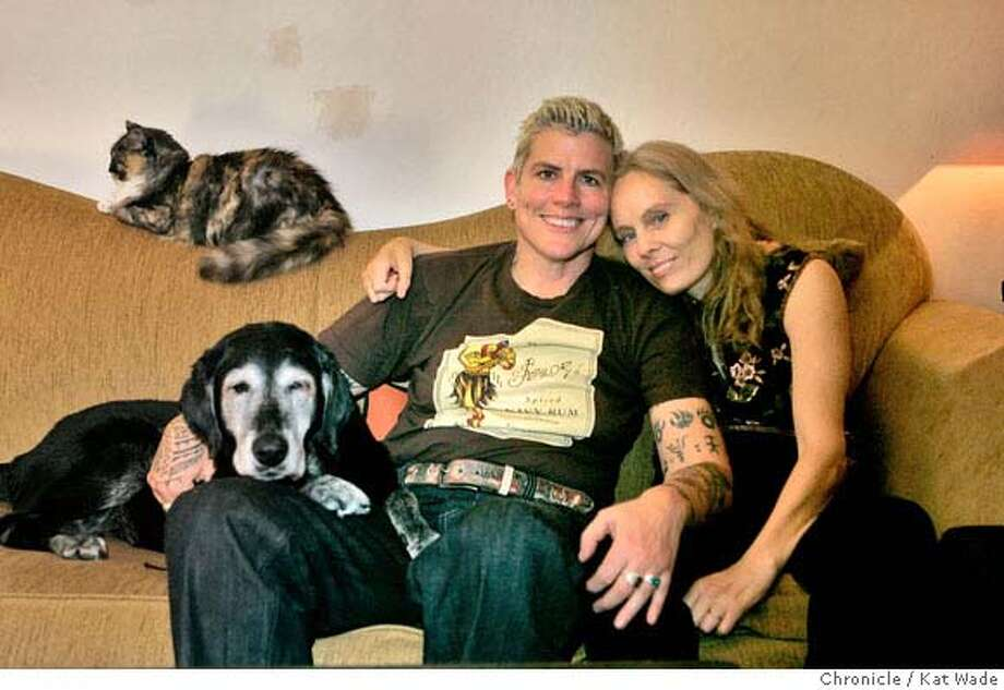 ONTHECOUCH_035_KW.JPG  Partners for 11-years, (L to R) Iva (CQ) Walton and Judy Smith pose for a portrait on their couch with their cat ,Muffin and dog, Cleo on Friday night 12/28/07 in Oakland, Ca . Photo by Kat Wade Iva Walton and Judy Smith (CQ, Subject) Photo: Kat Wade