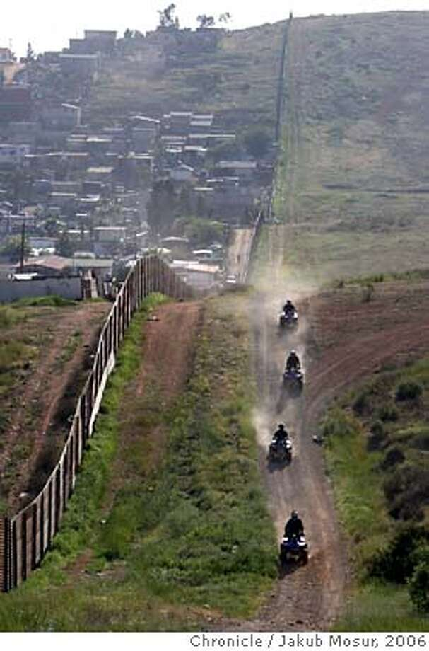 Border_06_JMM.JPG  United States Border Patrol officers on all-terrain vehicles search the border on May 5, 2006, east of the Otay Mesa border checkpoint in San Diego.  Event on 5/5/06 in San Diego.  JAKUB MOSUR / The Chronicle MANDATORY CREDIT FOR PHOTOG AND SF CHRONICLE/NO SALES-MAGS OUT Photo: JAKUB MOSUR