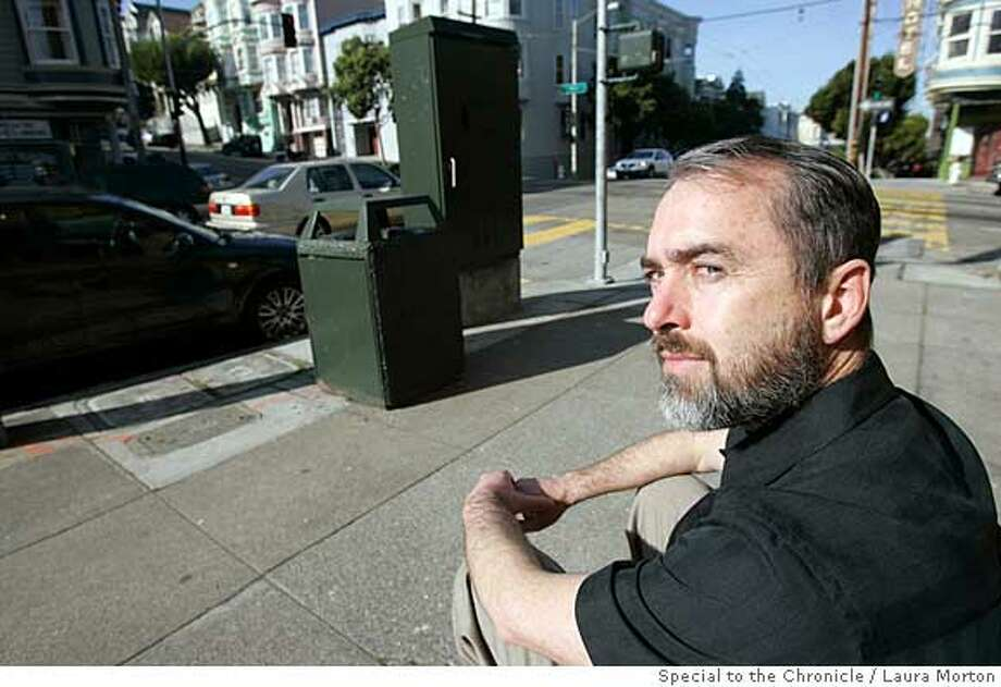 Willi Wolf sits at the intersection of Fillmore and Fell Streets, the site where he recently came across the remains of a gun battle. Wolf, who has lived in the neighborhood for 20 years, is concerned about the violence in the area. (Laura Morton/Special to the Chronicle) Ran on: 01-20-2008  Willi Wolf sits at the intersection of Fillmore and Fell streets, where he recently came across the aftermath of a shootout. Photo: Laura Morton