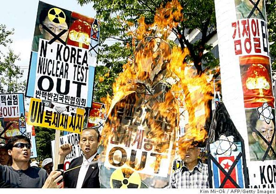 South Korean conservative protesters burn a portrait of North Korean leader Kim Jong-il during a rally denouncing its nuclear threat in front of the US embassy in Seoul on May 26, 2009.  North Korea reportedly fired two short-range missiles on May 26, in a move set to heighten tensions after its latest nuclear weapons on May 25 test drew global condemnation.     AFP PHOTO/KIM MI-OK (Photo credit should read KIM MI-OK/AFP/Getty Images) Photo: Kim Mi-Ok, AFP/Getty Images