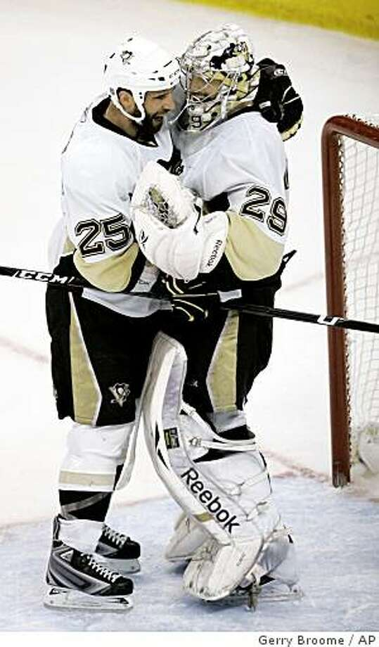 Pittsburgh Penguins goalie Marc-Andre Fleury (29) and Maxime Talbot (25) hug following Game 4 of the NHL hockey Eastern Conference finals in Raleigh, N.C., Tuesday, May 26, 2009. Pittsburgh defeated the Carolina Hurricanes 4-1 to win the series. (AP Photo/Gerry Broome) Photo: Gerry Broome, AP