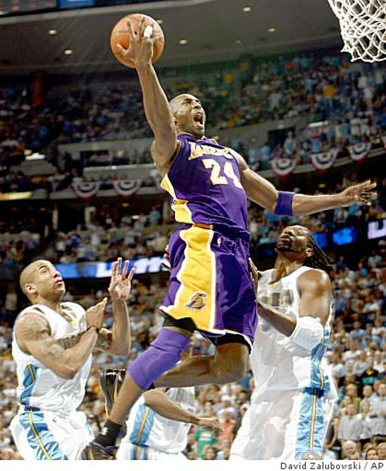 Los Angeles Lakers guard Kobe Bryant goes up for a dunk over the top of Denver Nuggets guard Dahntay Jones, left, and Nene during the second half of Game 3 of the NBA basketball Western Conference finals Saturday, May 23, 2009, in Denver.  (AP Photo/ David Zalubowski ) Photo: David Zalubowski, AP