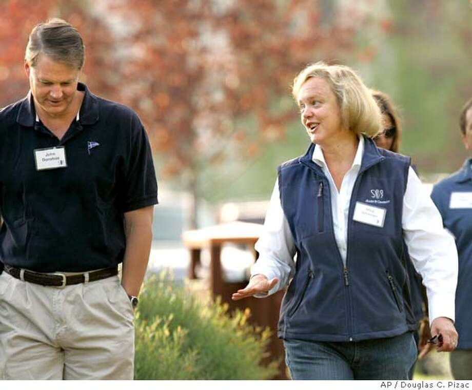 **FILE**EBay CEO Meg Whitman, right, talks with eBay's John Donahoe, left, as they arrive for the annual Allen and Co.'s media conference in this July 11, 2007, file photo, in Sun Valley, Idaho. Whitman, 51, had been reported to be plotting the move and handing the job to Donahoe, 47, who has been heading eBay's core auction and e-commerce businesses. She confirmed her March 31 departure as eBay reported fourth-quarter earnings Wednesday, Jan. 23, 2008. (AP Photo/Douglas C. Pizac, File) Photo: Douglas C. Pizac