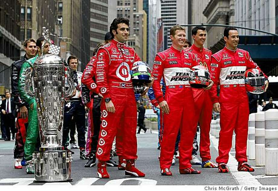 NEW YORK - MAY 18:  Dario Franchitti (L) driver of the #10 Target Chip Ganassi Racing Dallara Honda, Ryan Briscoe (C) driver of the #6 Team Penske Dallara Honda and Helio Castroneves, (R) driver of the #3 Team Penske Dallara Honda stand in the front row with the Indianapolis 500 trophy as all 33 IndyCar drivers lineup and pose for photos in the traditional Indianapolis 500 line up in Herald Square on May 18, 2009 in New York City. The drivers came to New York to promote the Indianapolis 500 which is the  fourth race on the 2009 IndyCar Series schedule.  (Photo by Chris McGrath/Getty Images) Photo: Chris McGrath, Getty Images