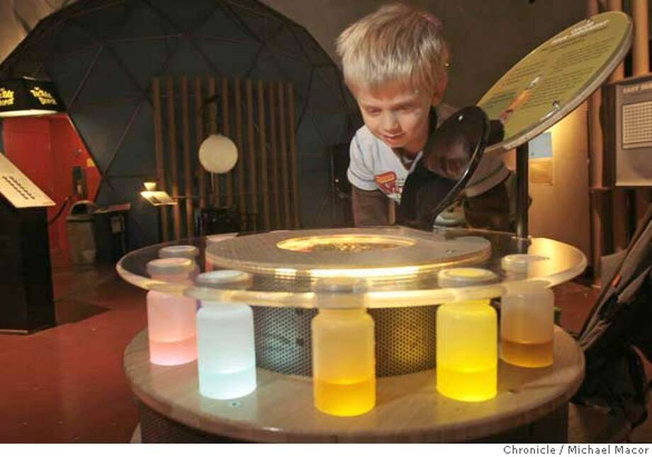 "exploratorium24_023_mac.jpg 3 year old J.J. Nelson of San Anselmo, explores how his sense of smell is influenced by colors. The Exploratorium in San Francsico has a new exhibit called, ""Mind"" that explores how the brain works using various hands on displays and interactive materials. Michael Macor / The Chronicle Taken on 1/23/08, in San Francisco, CA, USA  Ran on: 01-24-2008  J.J. Nelson, 3, of San Anselmo explores how his sense of smell is influenced by colors. Many of the exhibits are designed to trick the brain.  Ran on: 01-24-2008  J.J. Nelson, 3, of San Anselmo explores how his sense of smell is influenced by colors. Many of the exhibits are designed to trick the brain. Photo: Michael Macor"