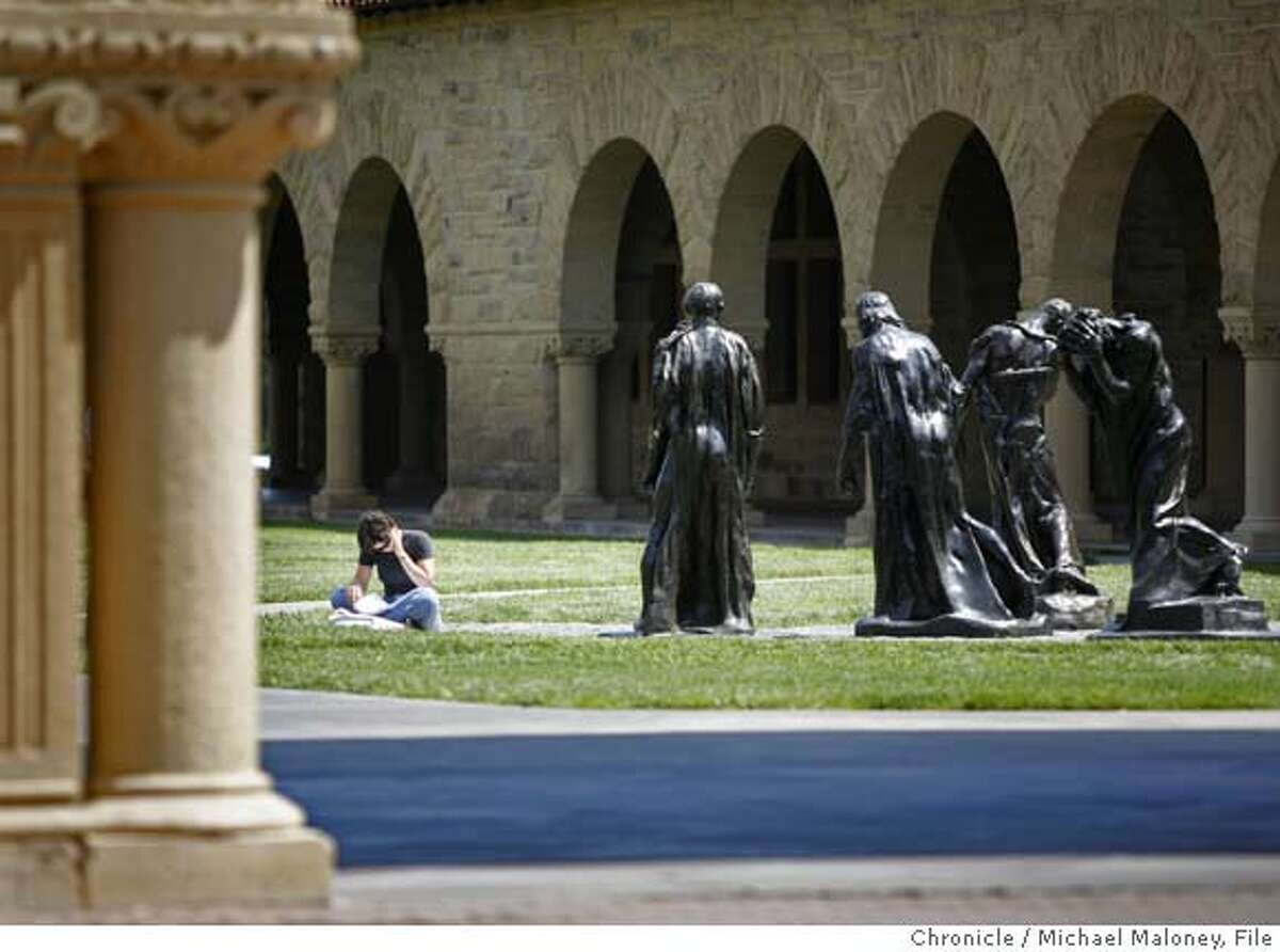 CAMPUSNOTES_MJM_026.jpg Stanford University senior, 21 year old Annie Wilkinson takes advantage of the warm weather to study outdoors in Memorial Court on the Stanford campus. Wilkinson, a human biology major from Missoula Montana was sitting next to the Auguste Rodin bronze sculptures titled