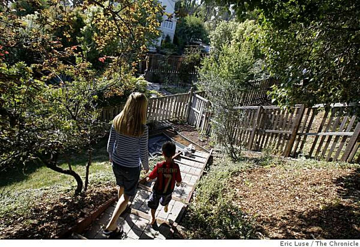 Artichokes in the front yard of Elizabeth Singh and her son Arjun,6, walk down to the family garden at her home photographed in San Anselmo on Monday, May 11, 2009.
